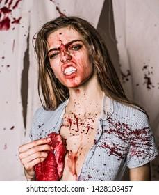 animal instinct. aggressive girl in blood. human internal organ trade. bloody halloween. anatomy. zombie. medical transplantation. cannibalism. donation and donar. meatman in butcher shop. butchery