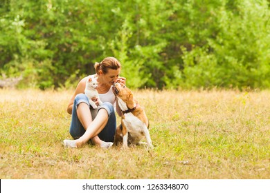 Animal lover sitting outside with her pets