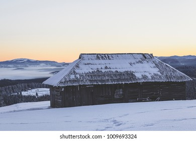 Animal shelter in the Carpathians and a view towards Giumalau Massif
