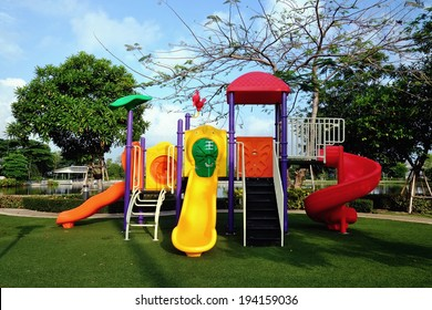 animal style colorful slides on artificial grass playground in park with sun shine and blue sky
