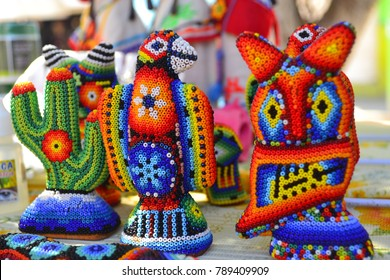 Animals made with Huichol art