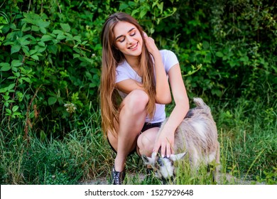 Animals are our pets. woman vet feeding goat. farm and farming. Animals are our friends. happy girl love goat. village weekend. summer day. Love and protect animals. contact zoo. veterinarian goat.