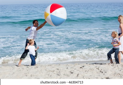 Animated family playing with a ball at the beach