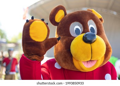 Animator in a bear costume. A man in a full-length suit for the holiday. Russian bear at the holiday.