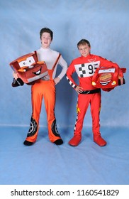Animator in the costume of Lightning McQueen and Meter of the tractor