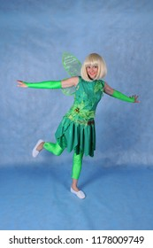 Animator in the costume of Tinker Bell in the Studio on a blue background, Moscow, June 10, 2014