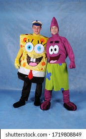 Animator dressed as characters from the cartoon Spongebob and Starfish in a Studio on a blue background in Moscow on June 10 2014