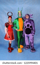 Animator dressed as a ladybug Mila, Luntik and Grasshopper from the cartoon Luntik and his friends, in the Studio on a blue background in Moscow June 10, 2014