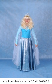 Animator in Elsa costume in the Studio on a blue background in Moscow June 10, 2014