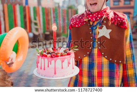 The Animator In A Suit Cowboy Holds Birthday Cake With Candle