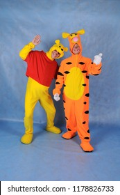 Animators in the costumes of Winnie the Pooh and Tiger cartoon Winnie the Pooh in the Studio on a blue background in Moscow June 10, 2014