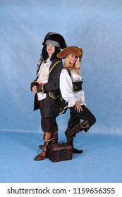 Animators dressed as pirate Jack Sparrow and Elizabeth with a chest in a Studio in Moscow June 10, 2014 on a blue background