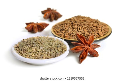 Anise, also called aniseed or Pimpinella anisum with fruits of star anise and  caraway. Isolated on white background.