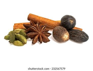 Anise, cardamom, nutmeg and cinnamon sticks on a white background. Spices.