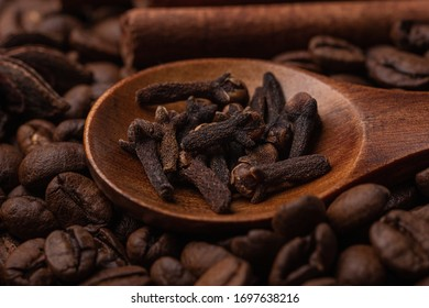 Anise, cinnamon sticks and cloves in a wooden spoon, macro - Shutterstock ID 1697638216