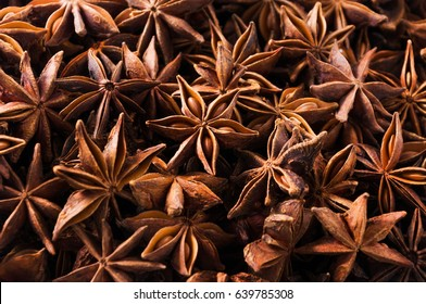 Anise star seeds, aromatic Asian spices ingredient in cooking, star anise background.
