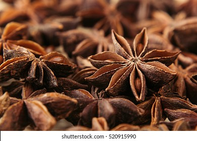 Anise star spice closeup background. Fragrant asian spices. Top view.