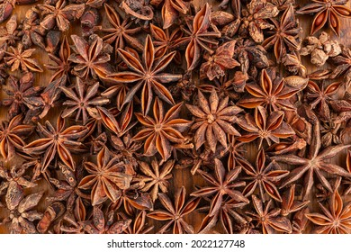 Anise stars on wooden for background, top view.