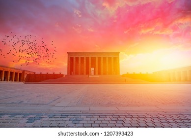 Anitkabir, Mausoleum of Ataturk with dramatic sunset sky with a flock of pigeon, Ankara Turkey