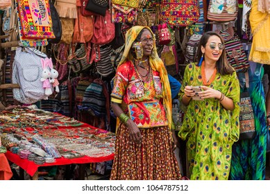 Anjuna Beach, Goa/India- April 4 2018: Street vendors selling goods and handicrafts to tourists at Anjuna Beach, Goa