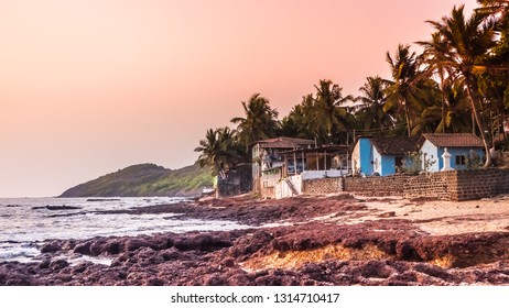Anjuna, Goa / India - 04 21 2017: Sunset bythe sea in the northern Goa at Anjuna beach, India. Anjuna beach with orange color sunset by the Arabian Sea. Stunning tropical and exotic landscape.
