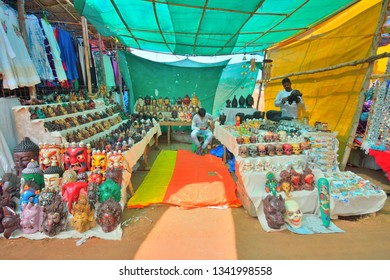 Anjuna, India - January 30, 2019: A street vendor selling wide variety of religious idols at the flea market.