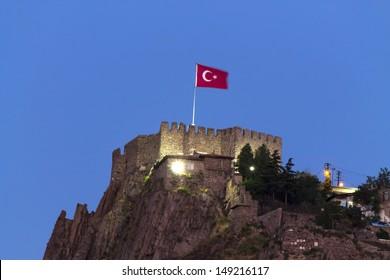 Ankara castle with Turkish flag at night, Ankara, Turkey.