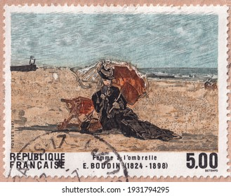 Ankara, Turkey- 03.07.2021: A stamp printed in the France.Shows Eugene Boudin's painting titled Woman under parasol. Circa 1987