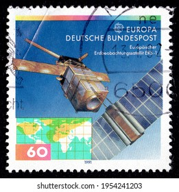 Ankara, Turkey - 12 April 2021: A Germany postage stamp shows an image of the European Earth observation satellite and world map as well as CEPT symbol and Europe. Circa 1991...
