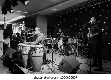 Ankara, Turkey - 18.05.2016: Famous Turkish singer Ayhan Sicimoglu and his band Latin Allstars on stage at Next Level shopping mall in a private fund raising concert.