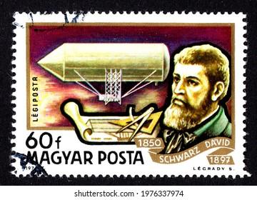 Ankara, Turkey - 19 May 2021: A Hungary postage stamp shows dedicated to the history of aviation, depicted David Schwarz and airship (1850). Circa 1977...