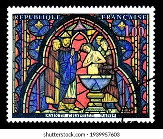 Ankara, Turkey - 20 March 2021: A France postage stamp shows The Baptism of Judas. Circa 1966. Canceled by seal...
