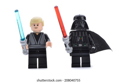 Ankara, Turkey - April 06, 2013: Close up of a Lego Star Wars Darth Vader and Luke Skywalker with lightsaber swords isolated on white background.