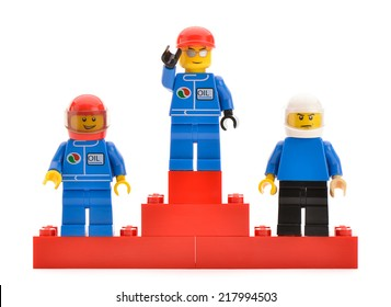 Ankara, Turkey - April 09, 2013:  Three top placed Lego minifigure drivers in a race stand on a podium for the trophy ceremony.