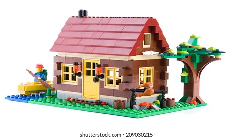 Ankara, Turkey - April 15, 2012: Lego Creator - Log Cabin is a 3 in 1 countryside houses packed with great details isolated on white background