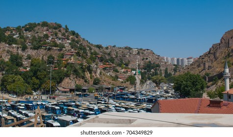 ANKARA, TURKEY - AUGUST,2 2017 -  city view from historical district: old buildings on the hill, new district with high buildings behind the hill and huge bus station on the foreground