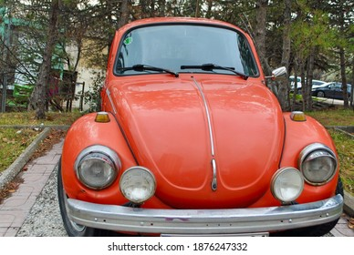 Ankara Turkey. Dec. 2020. Front view of a Classic bright orange Volkswagen 1973 Type 1303 Beetle, parked on a cobblestone street in a residential neighborhood.