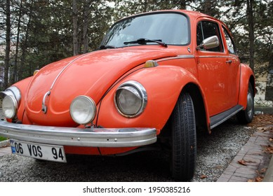 Ankara Turkey. Dec. 2020. Front view of a Classic legendary bright orange Volkswagen 1973 Type 1303 Beetle, parked on a cobblestone street in a residential neighborhood.