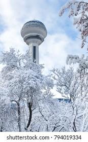 ANKARA, TURKEY - DECEMBER 25, 2017: Atakule and Botanic Park in snow. Atakule is one of the primary landmarks of Ankara. - Turkey