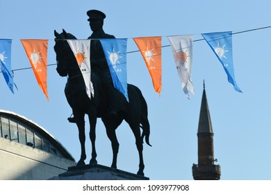 ANKARA, TURKEY - JANUARY 18, 2018: Flags of AK Party and Statue of Ataturk and a mosque minaret in Ulus, Ankara. The three symbols in Turkey symbolizes power struggle towards to Presidential elections