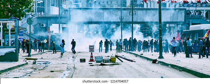 Ankara, Turkey - June, 2013: Protesters running away from the tear gas shells fired by the police during Gezi park protests in Ankara, Turkey. Editorial use.