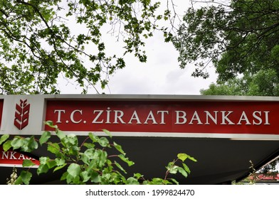 Ankara Turkey. June 2021. Signboard of Ziraat Banksi., Agriculture Bank among trees. A TC bank founded in 1863 with mission to help farmers and agricultural development in Turkey. Wheat harvest logo.