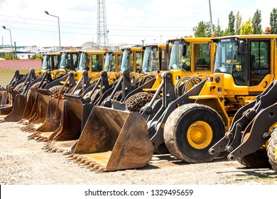 Ankara, Turkey - June 21, 2014 : Multiple Volvo tractors ( JCB ) all in a row on a heavy equipment auction