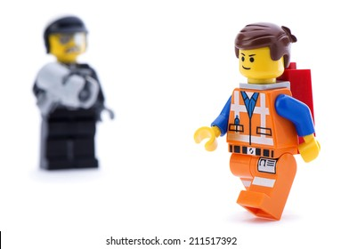 Ankara, Turkey - March 15, 2014 : Studio shot of Lego Movie bad cop trying to catch Emmet isolated on white background.