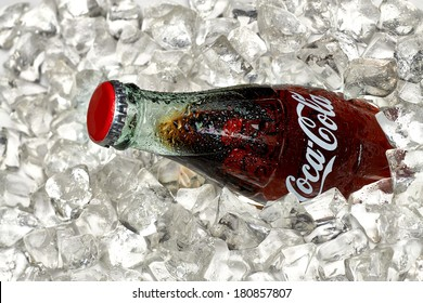 ANKARA, TURKEY - March 7, 2014: Editorial photo of Classic Coca-Cola Bottle in crushed ice.