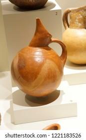 ANKARA, TURKEY - MAY 21, 2014 -  Ancient pottery with animals and hunting scenes,  from  Alaca, Corum, 1400 BCE Museum of Anatolian Civilization, Ankara, Turkey