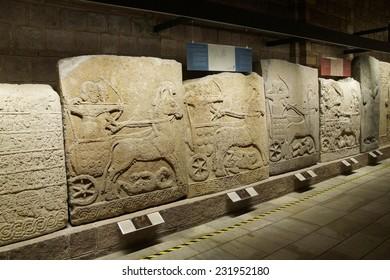 ANKARA, TURKEY - MAY 21, 2014 -  Hallway, Chariot with driver and archer, Orthostat stelesfrom Kargama about 800 BCE,  Ankara, Turkey
