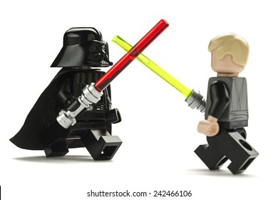 Ankara, Turkey - May 27, 2014: Lego Star Wars minifigure Darth Vader and Luke Skywalker are fighting with sword isolated on white background.
