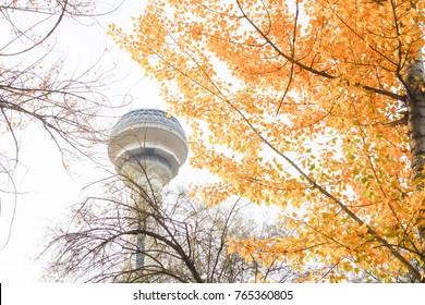 ANKARA, TURKEY - NOVEMBER 11, 2017: Atakule and autumn leaves. Atakule is one one of the primary landmarks of Ankara. - Turkey