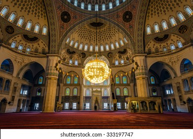 Ankara, Turkey - October 23, 2015: Kocatepe mosque interior in the evening. Every day local people and tourists are visiting the mosque and praying. Photography of slow shutter spead.
